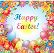 Easter card with colorful flowers and painted eggs