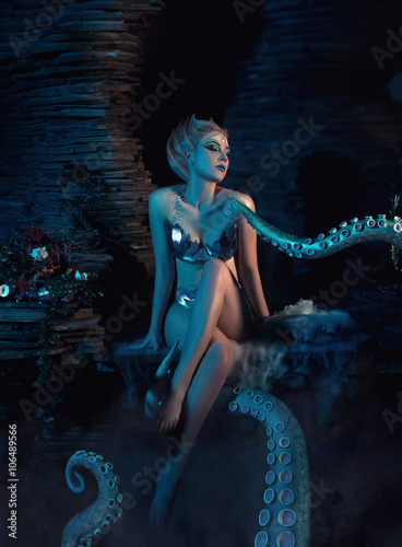 Zdjęcia na płótnie, fototapety, obrazy :  beautiful slim girl in the arms of an octopus, tentacles wrap around the body, fantastic shot, toning fashionable, creative colors