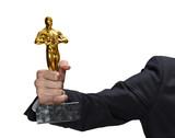hand holding oscar statue