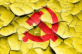 Grunge cracked Communist sign with red and yellow colors