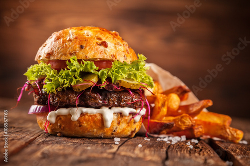 Fresh home-made hamburger served on wood - 106567768