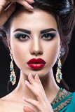 Beautiful brunette girl with arabic evening make-up and perfect skin. Beauty face. Close up - 106687707
