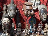 African masks and statues at a flea market