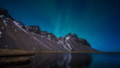 Northern Lights above a mountain and lake