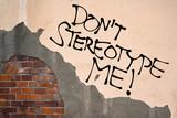 Handwritten graffiti Don't Stereotype Me! sprayed on the wall, anarchist aesthetics
