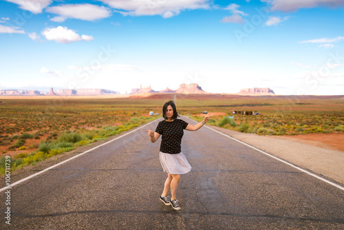 Poster Young woman joking in Monument Valley