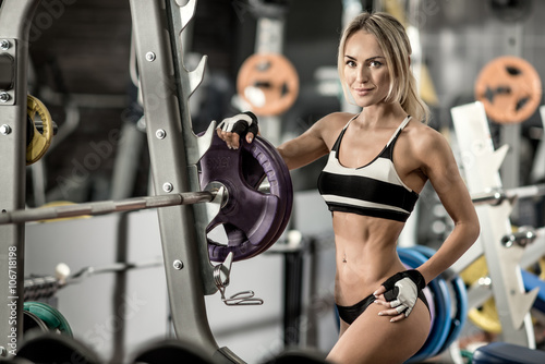 obraz lub plakat young fitness woman in gym