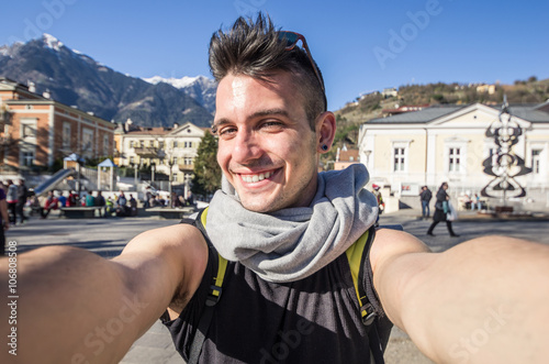 Poster Handsome young caucasian guy is taking a selfie outdoor - people, technology and