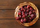 ripe organic red grapes in a copper bowl