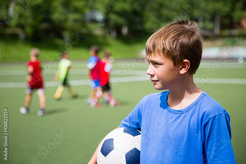 Young soccer player in training