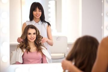Pleasant professional hairdresser working in the hairdressing salon  © Viacheslav Iakobchuk