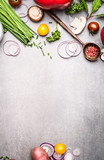 Fototapety Healthy cooking with fresh vegetables and seasoning ingredients on rustic stone background, top view, place for text., frame. Healthy lifestyle and diet food concept.