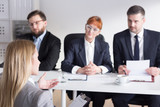 Three businesspeople during job interview with intern