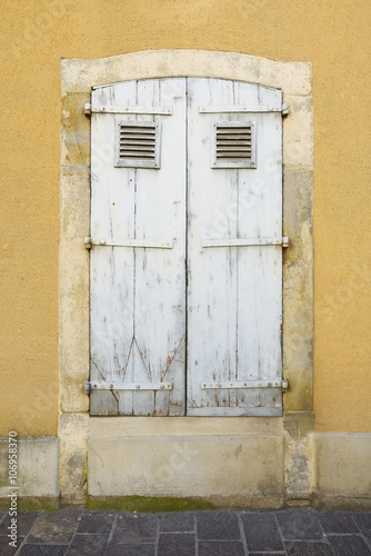 Exterior of a beautiful and ancient  wooden window in Provencal style © marcobarone