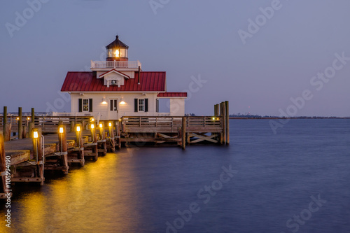 The Roanoke Marsh Lighthouse at Sunset плакат