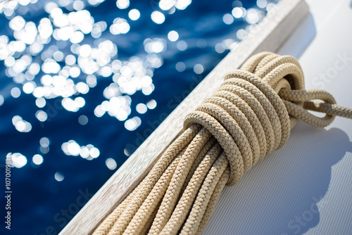 Yachting background - rope on board of small yacht - sail boat with sea in background