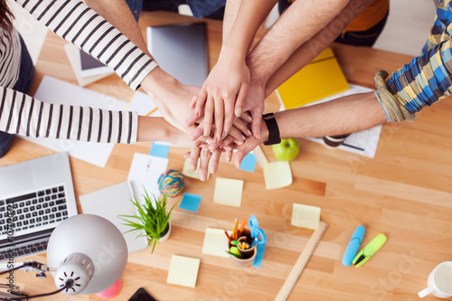 Cheerful friends are ready to work together