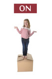 Fototapety sweet blond hair child stading on top of cardboard box isolated on white background  in learning english