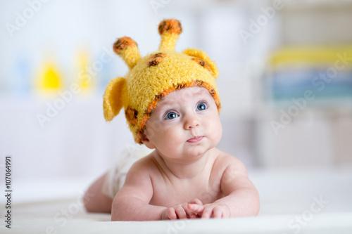 Poster baby child in costume of giraffe