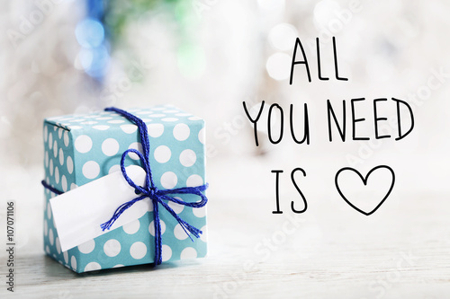 Poster All You Need Is Love message with gift box
