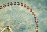 Ferris Wheel and clouds viewed from below