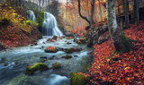 Fototapety Beautiful waterfall in autumn forest in crimean mountains at sun