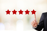 Fototapety Businessman hand pointing five star