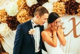 beautiful gorgeous brunete bride and stylish groom crying, celebrating wedding on the restaurant