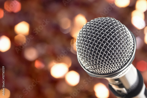 Poster close up microphone on night bokeh background abstract