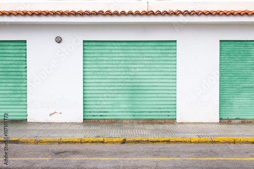 Industrial retro wall with coloured garages in spanish style