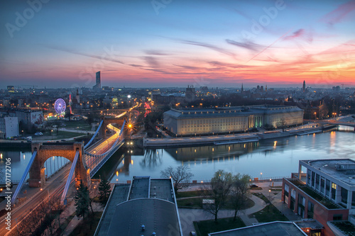 Zdjęcia na płótnie, fototapety na wymiar, obrazy na ścianę : WROCLAW, POLAND - APRIL 02, 2016: Aerial view of Wroclaw. Illuminated city skyline during a beautiful sunset, April 02, 2016 in Wroclaw, Poland.