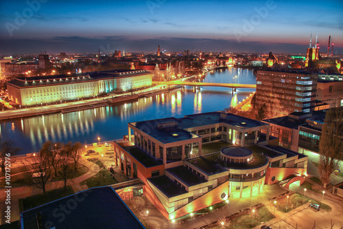 Fototapety, obrazy : WROCLAW, POLAND - APRIL 02, 2016: Aerial view of Wroclaw. Illuminated city skyline during a beautiful sunset, April 02, 2016 in Wroclaw, Poland.