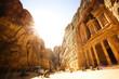 The Treasury (Al Khazneh) of Petra Ancient City with Golden Sun, Jordan