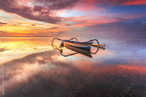 Beautiful Sunrise Scene in Bali, Indonesia. The boat ( Jukung) at Sanur Beach