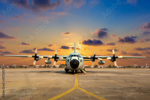 Poster Military aircraft on the runway during sunset.
