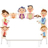 テーブルに座る三世代家族