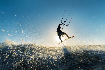 Surfer jumping at the sunset © Raul Mellado
