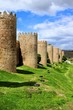 Mighty medieval wall and towers surrounding the old town of Avila, Spain