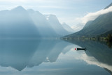 Fototapety Landscape with mountains reflecting in the water and small boat, Norway