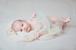 Detaily fotografie Beautiful baby looking into the eyes ivory background.Portrait n