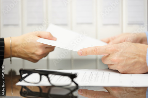 manager is giving employee termination of contract to read