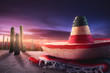 """Mexican hat """"sombrero"""" on a """"serape"""" in a mexican desert at twil"""