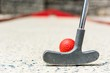 Closeup of red mini golf ball.