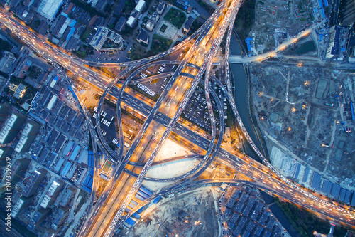 aerial view of traffic on road junction at night in hangzhou
