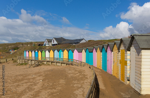 Bude Cornwall England uk colourful pastel beach huts on the beach Poster