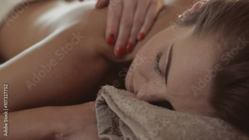 Tuinposter Gymnastiek Closeup of beautiful young woman reciving massage at day spa