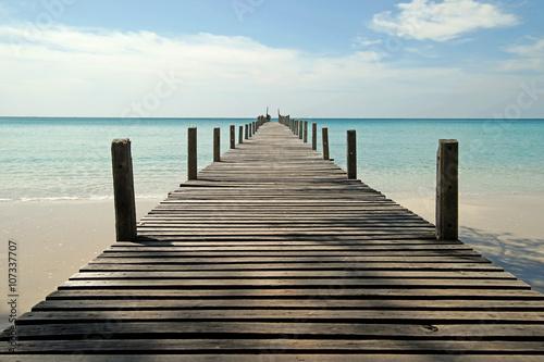 wooden jetty on sunny beach