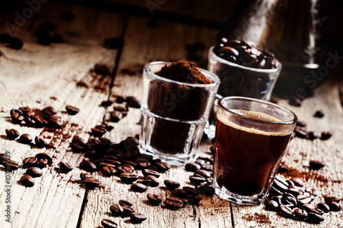 Fotobehang Koffiebonen Coffee beans, ground coffee, espresso in a glass, coffee, vintag