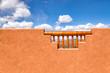 American Southwest Arizona style adobe wall frames a desert view