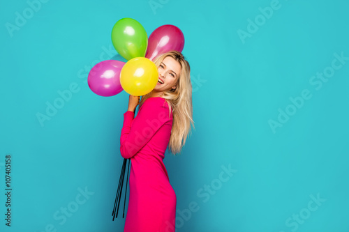 Poster blonde woman with balloons on blue